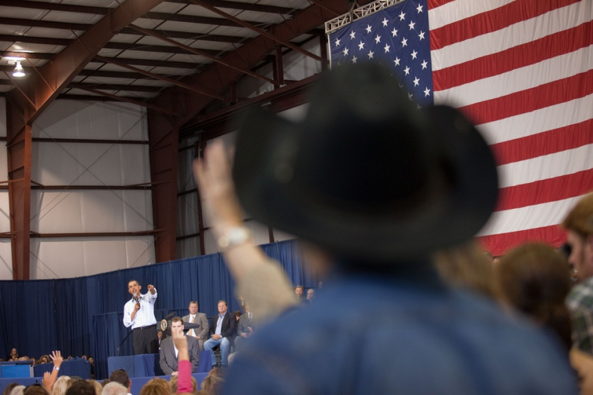 President Barack Obama points to a questioner during a town hall meeting on health care insurance reform inside a hangar at Gallatin Field in Belgrade, Montana, August 14, 2009. (Official White House Photo by Samantha Appleton) This official White House photograph is being made available only for publication by news organizations and/or for personal use printing by the subject(s) of the photograph. The photograph may not be manipulated in any way and may not be used in commercial or political materials, advertisements, emails, products, promotions that in any way suggests approval or endorsement of the President, the First Family, or the White House.