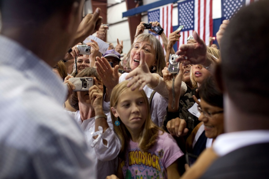 People in teh audience reach out to shake hands with President Barack Obama following his speaking on health care insurance reform at a town hall meeting held inside a hangar at Gallatin Field in Belgrade, Montana, August 14, 2009. (Official White House photo by Pete Souza) This official White House photograph is being made available only for publication by news organizations and/or for personal use printing by the subject(s) of the photograph. The photograph may not be manipulated in any way and may not be used in commercial or political materials, advertisements, emails, products, promotions that in any way suggests approval or endorsement of the President, the First Family, or the White House.