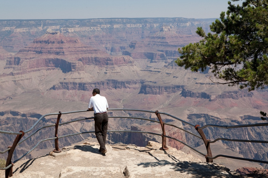 President Barack Obama looks at the vista before him during a tour of the Grand Canyon, August 16, 2009. (Official White House photo by Pete Souza) This official White House photograph is being made available only for publication by news organizations and/or for personal use printing by the subject(s) of the photograph. The photograph may not be manipulated in any way and may not be used in commercial or political materials, advertisements, emails, products, promotions that in any way suggests approval or endorsement of the President, the First Family, or the White House.