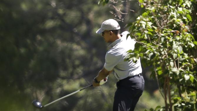 President Barack Obama tees off while golfing, Wednesday, Aug. 12, 2015, at Farm Neck Golf Club, in Oak Bluffs, Mass., on the island of Martha's Vineyard. The president, first lady Michelle Obama, and daughter Sasha are vacationing on the island. (AP Photo/Steven Senne)