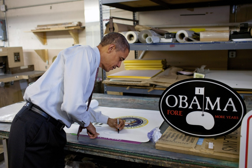 President Barack Obama autographs a banner following his remarks on the economy at Gelberg Signs in Washington, D.C., Aug. 6, 2010. (Official White House Photo by Pete Souza) This official White House photograph is being made available only for publication by news organizations and/or for personal use printing by the subject(s) of the photograph. The photograph may not be manipulated in any way and may not be used in commercial or political materials, advertisements, emails, products, promotions that in any way suggests approval or endorsement of the President, the First Family, or the White House.