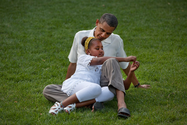 President Barack Obama sits with daughter Sasha during a barbecue with family and friends in celebration of his 49th birthday on the South Lawn of the White House, Aug. 8, 2010. (Official White House Photo by Pete Souza) This official White House photograph is being made available only for publication by news organizations and/or for personal use printing by the subject(s) of the photograph. The photograph may not be manipulated in any way and may not be used in commercial or political materials, advertisements, emails, products, promotions that in any way suggests approval or endorsement of the President, the First Family, or the White House.
