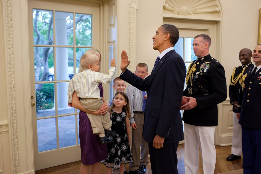 President Barack Obama greets Military Aide Lt. Col. Dave Kalinske and his family in the Oval Office, during KalinskeÕs departure ceremony, Aug. 13, 2010. (Official White House Photo by Pete Souza) This official White House photograph is being made available only for publication by news organizations and/or for personal use printing by the subject(s) of the photograph. The photograph may not be manipulated in any way and may not be used in commercial or political materials, advertisements, emails, products, promotions that in any way suggests approval or endorsement of the President, the First Family, or the White House.