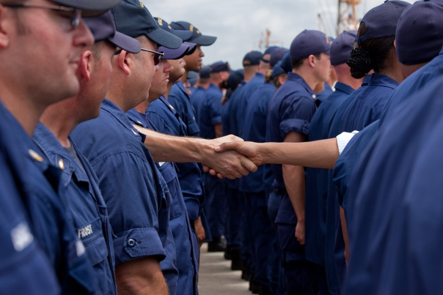 President Barack Obama greets members of the U.S. Coast Guard after making a statement at the U.S. Coast Guard Panama City District Office, Panama City, Fla, Saturday, Aug. 14, 2010. (Official White House Photo by Pete Souza) This official White House photograph is being made available only for publication by news organizations and/or for personal use printing by the subject(s) of the photograph. The photograph may not be manipulated in any way and may not be used in commercial or political materials, advertisements, emails, products, promotions that in any way suggests approval or endorsement of the President, the First Family, or the White House.