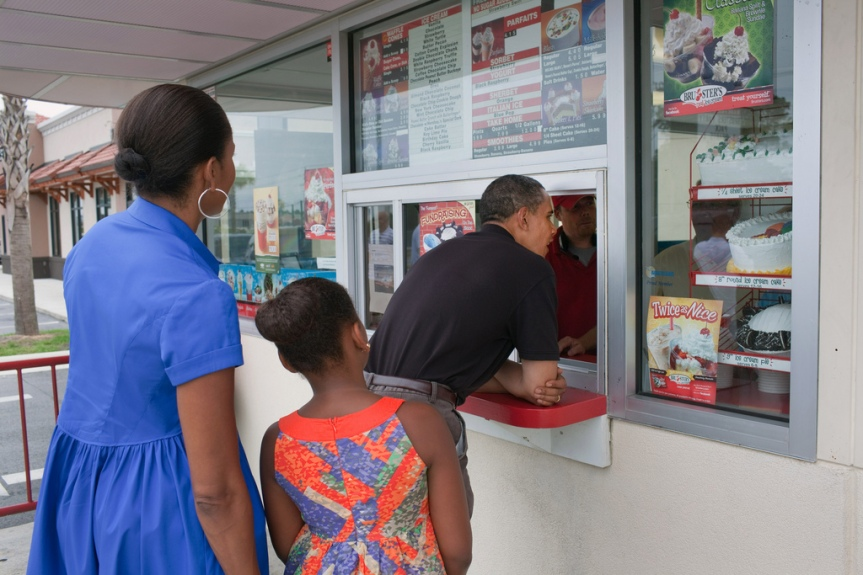 President Barack Obama, First Lady Michelle Obama, and daughter Sasha order ice cream at Bruster's in Panama City Beach, Fla., Aug. 15, 2010 (Official White House Photo by Pete Souza) This official White House photograph is being made available only for publication by news organizations and/or for personal use printing by the subject(s) of the photograph. The photograph may not be manipulated in any way and may not be used in commercial or political materials, advertisements, emails, products, promotions that in any way suggests approval or endorsement of the President, the First Family, or the White House.