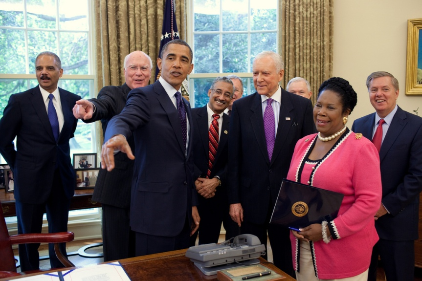 President Barack Obama talks with Members of Congress after signing the Fair Sentencing Act in the Oval Office, Aug. 3, 2010. Participants include: Attorney General Eric Holder, Sen. Patrick Leahy, D-Vt., Rep. Bobby Scott, D-Va., Senate Majority Whip Richard Durbin, of Ill., Sen. Jeff Sessions, R-Ala., Sen. Orrin Hatch, R-Utah, Rep. Sheila Jackson-Lee, D-Texas, and Sen. Lindsey Graham, R-SC.  (Official White House Photo by Pete Souza) This official White House photograph is being made available only for publication by news organizations and/or for personal use printing by the subject(s) of the photograph. The photograph may not be manipulated in any way and may not be used in commercial or political materials, advertisements, emails, products, promotions that in any way suggests approval or endorsement of the President, the First Family, or the White House.