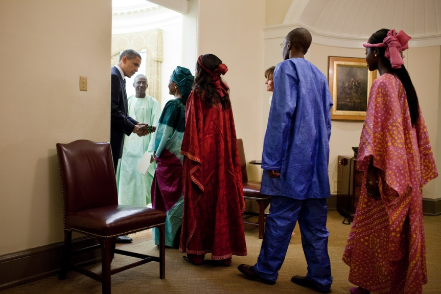 President Barack Obama greets Ambassador Alieu Momodou Ngum, of Republic of The Gambia, and his family before the start of an ambassador credentialing ceremony in the Oval Office, Aug. 10, 2010. The presentation of credentials is a traditional ceremony that marks the formal beginning of an ambassadorÕs service in Washington. (Official White House Photo by Pete Souza) This official White House photograph is being made available only for publication by news organizations and/or for personal use printing by the subject(s) of the photograph. The photograph may not be manipulated in any way and may not be used in commercial or political materials, advertisements, emails, products, promotions that in any way suggests approval or endorsement of the President, the First Family, or the White House.
