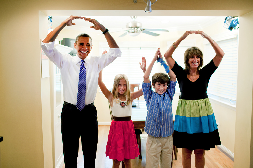 """President Barack Obama helps spell out """"Ohio"""" with the Weithman family, Rachel, 9, Josh, 11, and mom Rhonda, in their home in Columbus, Ohio, Aug. 18, 2010. (Official White House Photo by Pete Souza) This official White House photograph is being made available only for publication by news organizations and/or for personal use printing by the subject(s) of the photograph. The photograph may not be manipulated in any way and may not be used in commercial or political materials, advertisements, emails, products, promotions that in any way suggests approval or endorsement of the President, the First Family, or the White House."""