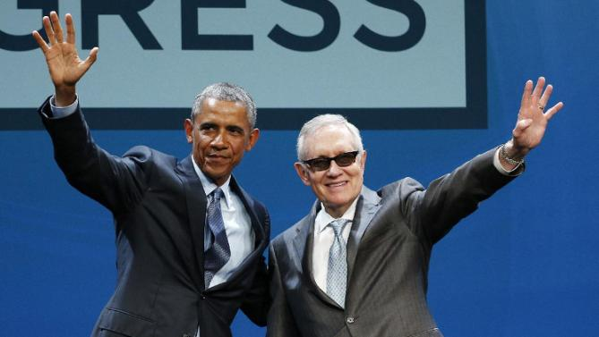 President Barack Obama, left, and Senate Minority Leader Sen. Harry Reid wave onstage at the National Clean Energy Summit, Monday, Aug. 24, 2015, in Las Vegas. The President is scheduled to spend the night in Nevada. (AP Photo/John Locher)