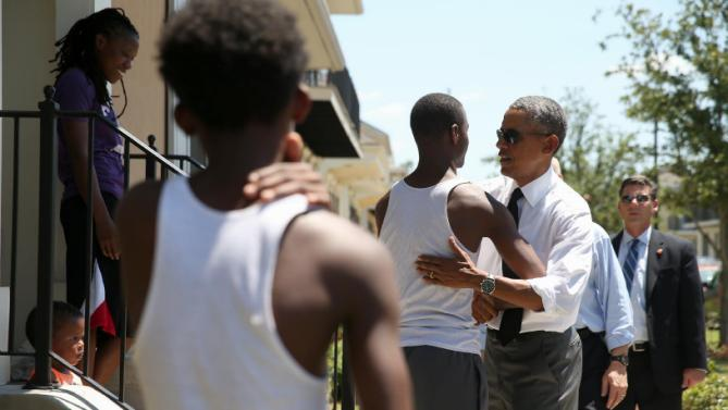 President Barack Obama greets residents in the the Tremé neighborhood in New Orleans, Thursday, Aug. 27, 2015, for the 10th anniversary since the devastation of Hurricane Katrina. Tremé is one of the oldest black neighborhoods in America, which borders the French Quarter just north of Downtown.(AP Photo/Andrew Harnik)