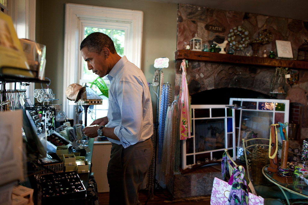 President Barack Obama browses crafts and antiques at Grasshoppers store in LeClaire, Iowa, Aug. 16, 2011, during a three-day bus tour in the Midwest. (Official White House Photo by Pete Souza) This official White House photograph is being made available only for publication by news organizations and/or for personal use printing by the subject(s) of the photograph. The photograph may not be manipulated in any way and may not be used in commercial or political materials, advertisements, emails, products, promotions that in any way suggests approval or endorsement of the President, the First Family, or the White House.