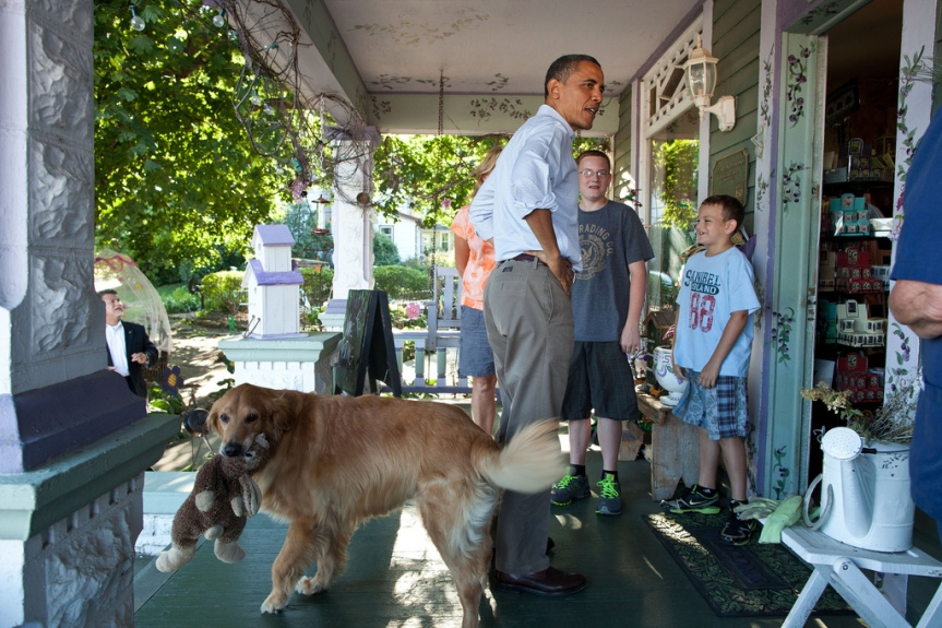 President Barack Obama talks with people at Grasshoppers store in LeClaire, Iowa, Aug. 16, 2011, during a three-day bus tour in the Midwest. (Official White House Photo by Pete Souza) This official White House photograph is being made available only for publication by news organizations and/or for personal use printing by the subject(s) of the photograph. The photograph may not be manipulated in any way and may not be used in commercial or political materials, advertisements, emails, products, promotions that in any way suggests approval or endorsement of the President, the First Family, or the White House.