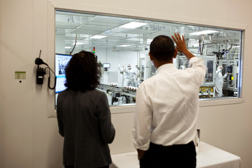 President Barack Obama tours Johnson Controls Inc. with Elizabeth Rolinski, Vice President of Operations, in Holland, Mich., Aug. 11, 2011. (Official White House Photo by Pete Souza) This official White House photograph is being made available only for publication by news organizations and/or for personal use printing by the subject(s) of the photograph. The photograph may not be manipulated in any way and may not be used in commercial or political materials, advertisements, emails, products, promotions that in any way suggests approval or endorsement of the President, the First Family, or the White House.