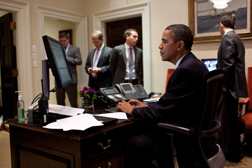 President Barack Obama works on his statement on the compromise reached to reduce the deficit and avert a default, in the Outer Oval Office, Aug. 2, 2011. Standing in the background are, from left: Director of Communications Dan Pfeiffer; Press Secretary Jay Carney; Jon Lovett, Associate Director of Speechwriting; and Senior Advisor David Plouffe. (Official White House Photo by Pete Souza) This official White House photograph is being made available only for publication by news organizations and/or for personal use printing by the subject(s) of the photograph. The photograph may not be manipulated in any way and may not be used in commercial or political materials, advertisements, emails, products, promotions that in any way suggests approval or endorsement of the President, the First Family, or the White House.