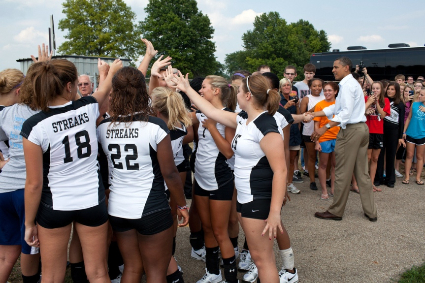 Galesburg Senior High volleyball players join in a cheer after meeting President Barack Obama during an unannounced stop in Galesburg, Ill., Aug. 17, 2011, as part of a three-day bus tour in the Midwest. (Official White House Photo by Pete Souza) This official White House photograph is being made available only for publication by news organizations and/or for personal use printing by the subject(s) of the photograph. The photograph may not be manipulated in any way and may not be used in commercial or political materials, advertisements, emails, products, promotions that in any way suggests approval or endorsement of the President, the First Family, or the White House.