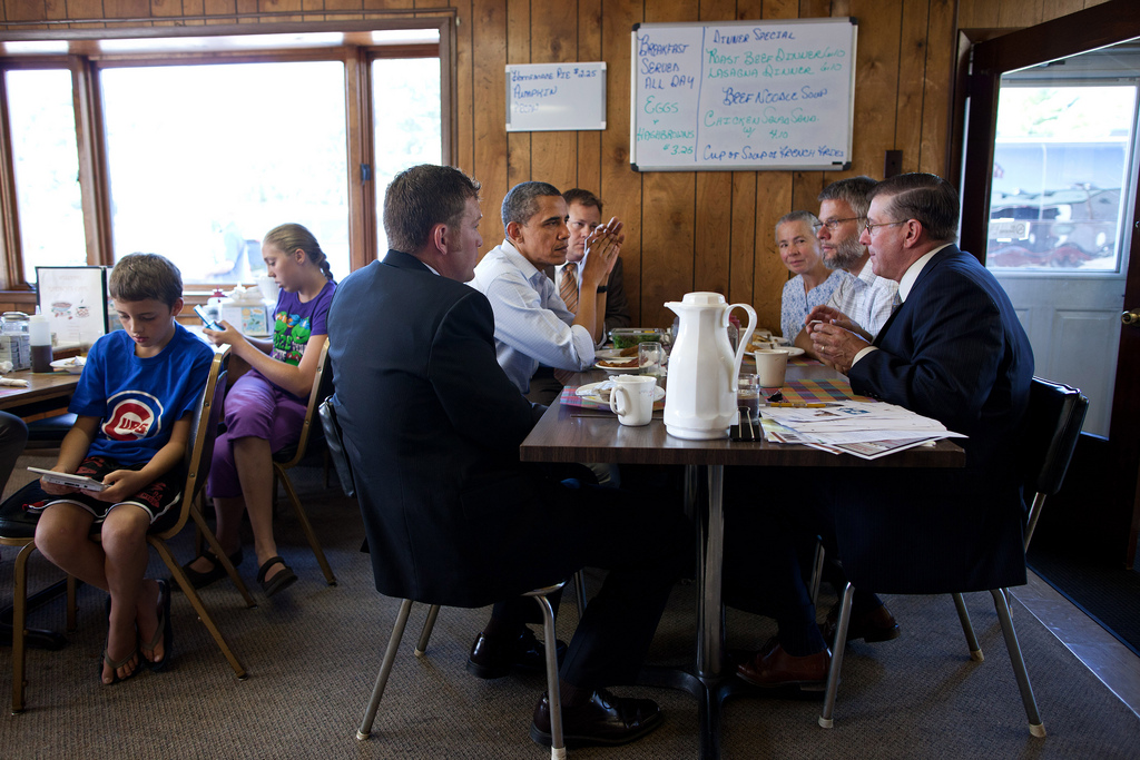 President Barack Obama has breakfast with small business owners at RauschÕs Cafe in Guttenberg, Iowa, during a three-day bus tour in the Midwest, Aug.16, 2011. (Official White House Photo by Pete Souza) This official White House photograph is being made available only for publication by news organizations and/or for personal use printing by the subject(s) of the photograph. The photograph may not be manipulated in any way and may not be used in commercial or political materials, advertisements, emails, products, promotions that in any way suggests approval or endorsement of the President, the First Family, or the White House.