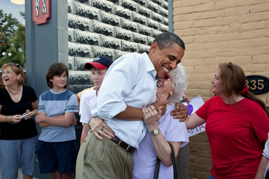 President Barack Obama greets people outside the Old Market Deli in Cannon Falls, Minn. Aug. 15, 2011. The President stopped to have lunch with five post-9/11 veterans from Minnesota during a three-day bus tour in the Midwest. (Official White House Photo by Samantha Appleton) This official White House photograph is being made available only for publication by news organizations and/or for personal use printing by the subject(s) of the photograph. The photograph may not be manipulated in any way and may not be used in commercial or political materials, advertisements, emails, products, promotions that in any way suggests approval or endorsement of the President, the First Family, or the White House.
