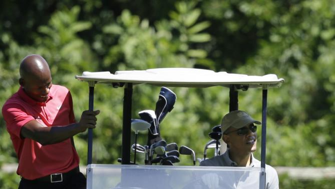 NBA Basketball player Ray Allen, left, steps into a golf cart driven by President Barack Obama while, golfing Wednesday, Aug. 12, 2015, at Farm Neck Golf Club, in Oak Bluffs, Mass., on the island of Martha's Vineyard. The president, first lady Michelle Obama, and daughter Sasha are vacationing on the island. (AP Photo/Steven Senne)