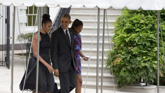 President Barack Obama, first lady Michelle Obama, and their daughter Sasha walk from the White House in Washington, Friday, Aug. 7, 2015, to board Marine One on the South Lawn for a short trip to Andrews Air Force Base, Md., then onto Martha's Vineyard, Mass., for a family vacation. (AP Photo/Carolyn Kaster)