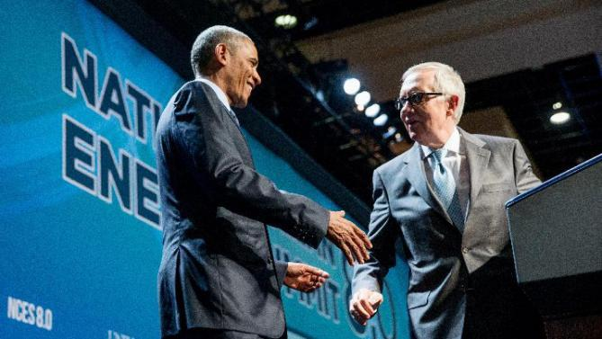 President Barack Obama is greeted by Senate Minority Leader Sen. Harry Reid, right, as he arrives to speak at the National Clean Energy Summit at the Mandalay Bay Resort Convention Center, Monday, Aug. 24, 2015, in Las Vegas. The President used the speech to announce a set of executive actions and other efforts aimed at making it easier for homeowners and businesses to invest in green energy improvements. (AP Photo/Andrew Harnik)