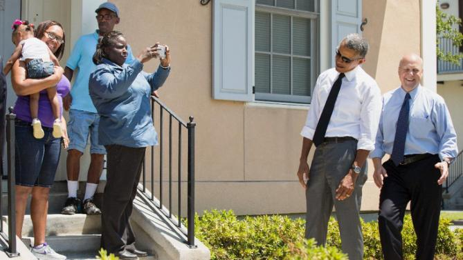 President Barack Obama, accompanied by New Orleans Mayor Mitch Landrieu, right, teases a shy girl as he greets residents in the the Tremé neighborhood in New Orleans, Thursday, Aug. 27, 2015, for the 10th anniversary since the devastation of Hurricane Katrina. Tremé is one of the oldest black neighborhoods in America, which borders the French Quarter just north of Downtown. (AP Photo/Andrew Harnik)