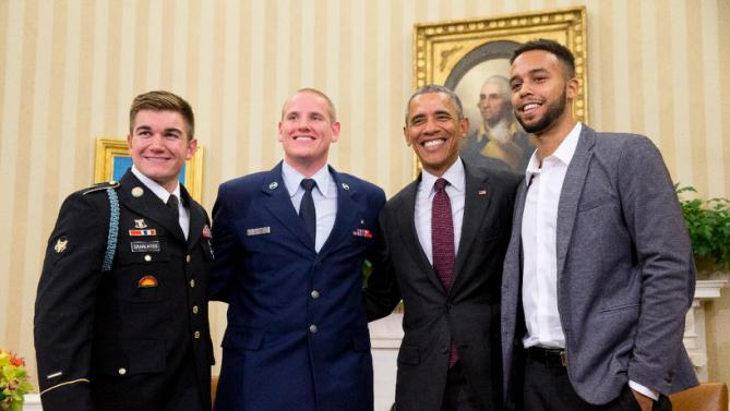 President Barack Obama poses for a photograph with Oregon National Guardsman, from left, Alek Skarlatos Air Force Airman 1st Class Spencer Stone, and Anthony Sadler, in the Oval Office of the White House in Washington, Thursday, Sept. 17, 2015, to honor them for heroically subduing a gunman on a passenger train in Paris last month. (AP Photo/Andrew Harnik)