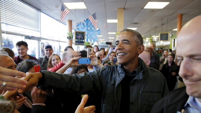 U.S. President Barack Obama greets patrons in Snow City Cafe in Anchorage, Alaska, September 1, 2015. Obama on Tuesday proposed a faster timetable for buying a new heavy icebreaker for the U.S. Arctic, where quickly melting sea ice has spurred more maritime traffic, and the United States has fallen far behind Russian resources. The move, part of a push to convince Americans to support Obama's plans to curb climate change, has long been urged by Arctic advocates as climate change opens up the region to more shipping, mining and drilling. REUTERS/Jonathan Ernst