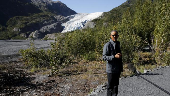 U.S. President Barack Obama stops to make remarks to reporters as he hikes to the Exit Glacier at Kenai Fjords National Park in Seward, Alaska, September 1, 2015. President Barack Obama on Tuesday proposed a faster timetable for buying a new heavy icebreaker for the U.S. Arctic, where quickly melting sea ice has spurred more maritime traffic and the United States has fallen far behind Russian resources. REUTERS/Jonathan Ernst
