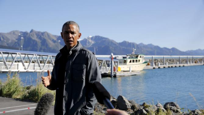 U.S. President Barack Obama delivers remarks before taking a boat tour of Kenai Fjords National Park in Seward, Alaska September 1, 2015. During a three-day visit Obama is also slated to meet people in remote Arctic communities whose way of life is affected by rising ocean levels, creating images designed to build support for regulations to curb carbon emissions. REUTERS/Jonathan Ernst