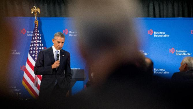 President Barack Obama pauses while speaking to business leaders at the quarterly meeting of the Business Roundtable in Washington, Wednesday, Sept. 16, 2015, to renew his calls for increased spending in infrastructure, education and scientific research. (AP Photo/Andrew Harnik)