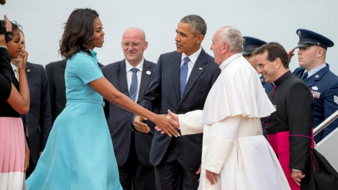 First lady Michelle Obama, accompanied by President Barack Obama, greet Pope Francis upon his arrival at Andrews Air Force Base, Md., Tuesday, Sept. 22, 2015. (AP Photo/Andrew Harnik)