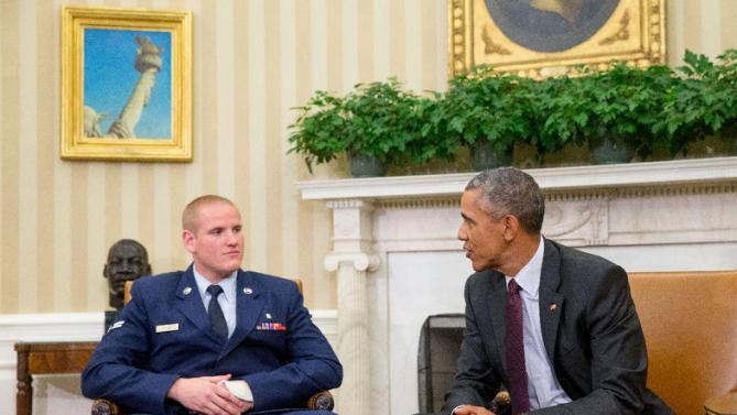 CORRECTS TO PARIS-BOUND TRAIN - President Barack Obama speaks to Air Force Airman 1st Class Spencer Stone, left, as he meets with Stone, Oregon National Guardsman Alek Skarlatos, and Anthony Sadler in the Oval Office of the White House in Washington, Thursday, Sept. 17, 2015, to honor them for heroically subduing a gunman on a Paris-bound passenger train last month. (AP Photo/Andrew Harnik)