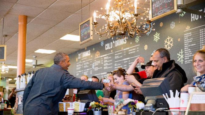 President Barack Obama visits with guests at Snow City Cafe in Anchorage, Alaska, Tuesday, Sept. 1, 2015. Obama is on a historic three-day trip to Alaska aimed at showing solidarity with a state often overlooked by Washington, while using its glorious but changing landscape as an urgent call to action on climate change. (AP Photo/Andrew Harnik)