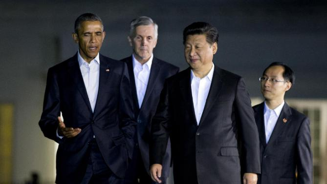 President Barack Obama and Chinese President Xi Jinping, front right, walk from the West Wing of the White House in Washington, Thursday, Sept. 24, 2015, for a private dinner at the Blair House, across the street from the White House. Xi arrived in Washington late Thursday for a State Visit. Obama has invested more time building personal ties with the Chinese president than with most other world leaders. (AP Photo/Manuel Balce Ceneta)