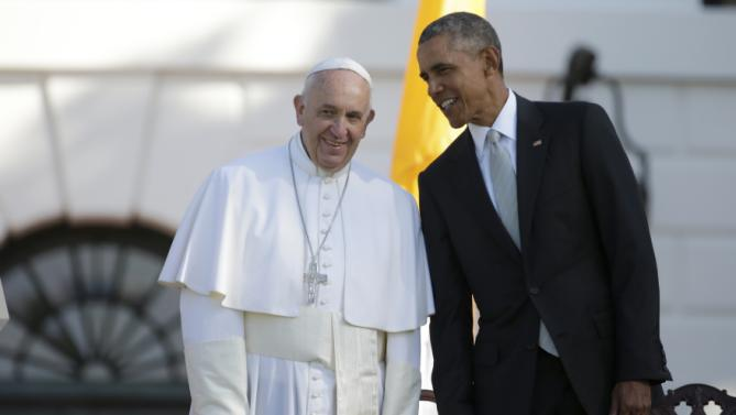 President Barack Obama leans over to talk to Pope Francis during a state arrival ceremony on the South Lawn of the White House in Washington, Wednesday, Sept. 23, 2015. (AP Photo/Pablo Martinez Monsivais)