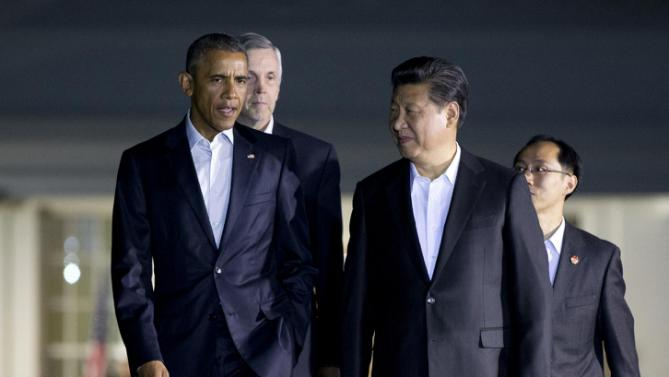 President Barack Obama and Chinese President Xi Jinping, right, walk from the West Wing of the White House in Washington, Thursday, Sept. 24, 2015, for a private dinner at the Blair House, across the street from the White House. Xi arrived in Washington late Thursday for a State Visit. Obama has invested more time building personal ties with the Chinese president than with most other world leaders. (AP Photo/Manuel Balce Ceneta)