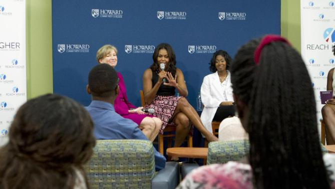 First lady Michelle Obama speaks to students during her visit to a career and technical training program at Howard Community College as part of her 'Reach Higher' initiative, Thursday, Sept. 17, 2015, in Columbia, Md., Thursday, Sept. 17, 2015. (AP Photo/Jose Luis Magana) .