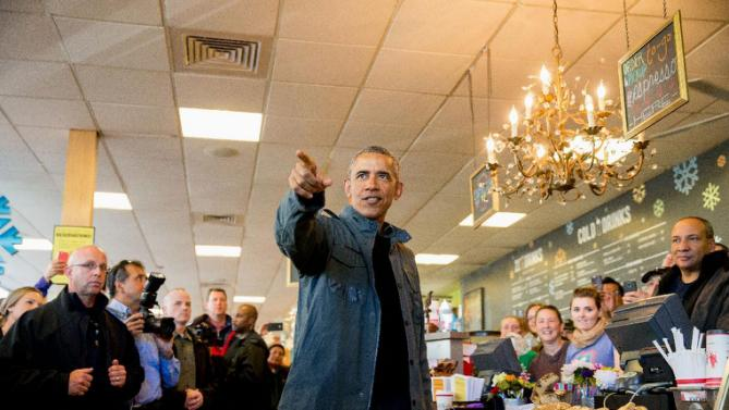 President Barack Obama speaks during a visit to the Snow City Cafe in Anchorage, Alaska, Tuesday, Sept. 1, 2015. Obama is on a historic three-day trip to Alaska aimed at showing solidarity with a state often overlooked by Washington, while using its glorious but changing landscape as an urgent call to action on climate change. (AP Photo/Andrew Harnik)