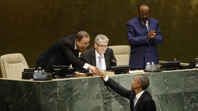 United States President Barack Obama, bottom, greets United Nations Secretary-General Ban Ki-moon after addressing the 70th session of the United Nations General Assembly at U.N. headquarters, Monday, Sept. 28, 2015. (AP Photo/Mary Altaffer)