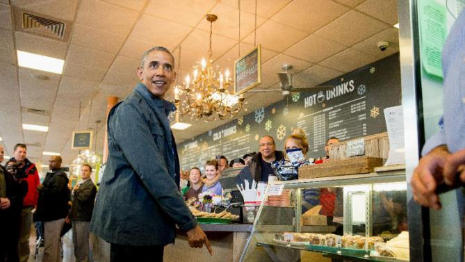 President Barack Obama points to a pastry display at the Snow City Cafe in Anchorage, Alaska, Tuesday, Sept. 1, 2015. Obama is on a historic three-day trip to Alaska aimed at showing solidarity with a state often overlooked by Washington, while using its glorious but changing landscape as an urgent call to action on climate change. (AP Photo/Andrew Harnik)