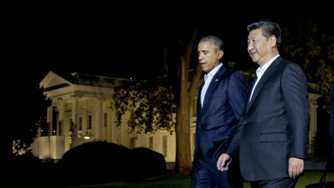 President Barack Obama and Chinese President Xi Jinping, right, walk on the North Lawn of the White House in Washington, Thursday, Sept. 24, 2015, heading for a private dinner at the Blair House, across the street from the White House. Xi arrived in Washington late Thursday for a State Visit. Obama has invested more time building personal ties with the Chinese president than with most other world leaders. (AP Photo/Manuel Balce Ceneta)
