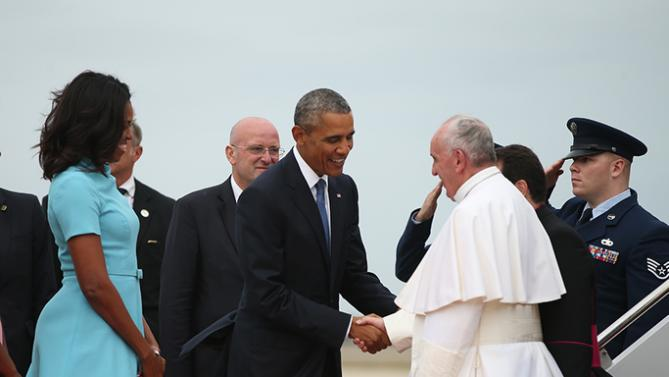 President Barack Obama and first lady Michelle Obama greet Pope Francis upon his arrival at Andrews Air Force Base, Md., Tuesday, Sept. 22, 2015. (AP Photo/Andrew Harnik)