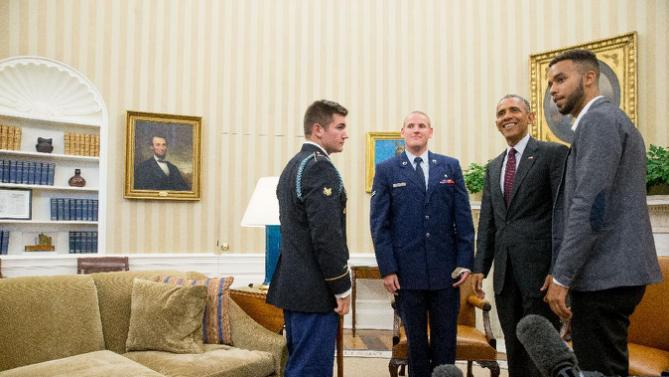 President Barack Obama meets with, from left, Oregon National Guardsman Alek Skarlatos, Air Force Airman 1st Class Spencer Stone, and Anthony Sadler, in the Oval Office of the White House in Washington, Thursday, Sept. 17, 2015, to honor them for heroically subduing a gunman on a passenger train in Paris last month. (AP Photo/Andrew Harnik)
