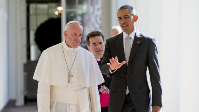 President Barack Obama and Pope Francis, accompanied by Msgr. Mark Miles, the English translator for the Pontiff, walk down the Colonnade before meeting in the Oval Office of the White House in Washington, Wednesday, Sept. 23, 2015. (AP Photo/Andrew Harnik)