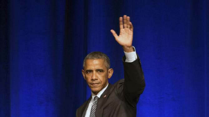 President Barack Obama waves to the crowd after speaking at a Democratic National Committee LGBT fundraising gala, Sunday, Sept. 27, 2015, held at Gotham Hall in New York. (AP Photo/Andrew Harnik)