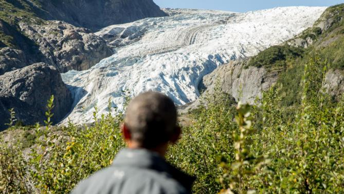 President Barack Obama pauses to view the Exit Glacier in Seward, Alaska, Tuesday, Sept. 1, 2015, which according to National Park Service research, has retreated approximately 1.25 miles over the past 200 years. Obama is on a historic three-day trip to Alaska aimed at showing solidarity with a state often overlooked by Washington, while using its glorious but changing landscape as an urgent call to action on climate change. (AP Photo/Andrew Harnik)