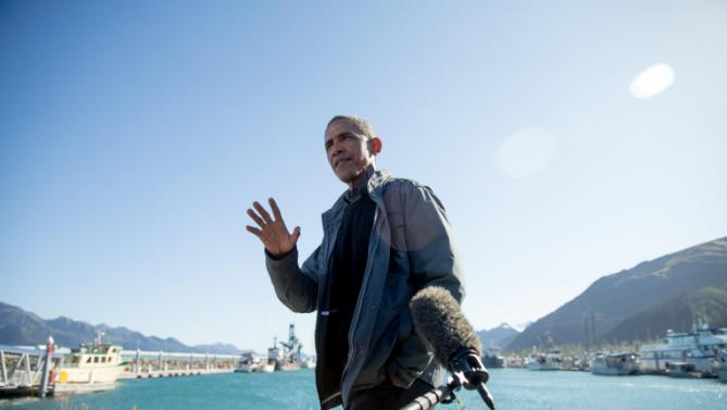 President Barack Obama speaks to reporters before taking a boat tour at the Kenai Fjords National Park, Tuesday, Sept. 1, 2015, in Seward, Alaska. Obama is on a historic three-day trip to Alaska aimed at showing solidarity with a state often overlooked by Washington, while using its glorious but changing landscape as an urgent call to action on climate change. (AP Photo/Andrew Harnik)