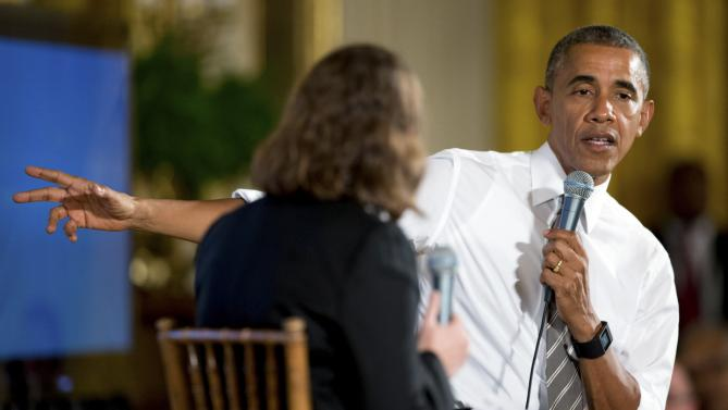 President Barack Obama, accompanied by Michelle Miller, co-founder of coworker.org, left, speaks during a conversation co-hosted by Coworker.org during the White House Summit on Worker Voice, Wednesday, Oct. 7, 2015, in the East Room of the White House in Washington. Workers, employers, unions, organizers and other advocates were meeting on how to energize a new generation of Americans to come together and recognize the potential power of their voice at work. (AP Photo/Andrew Harnik)
