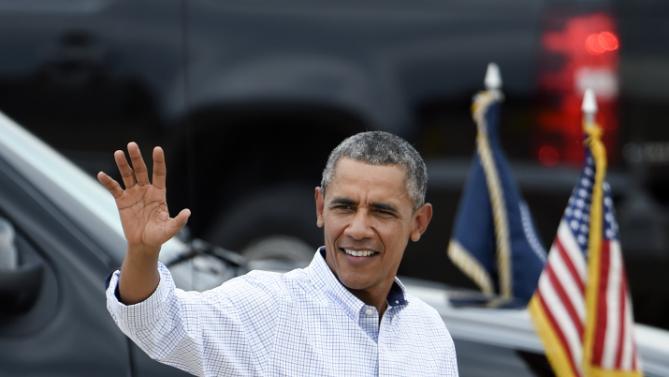 President Barack Obama waves as he leaves Marine Corps Air Station Miramar in San Diego Monday, Oct. 12, 2015. (AP Photo/Denis Poroy)