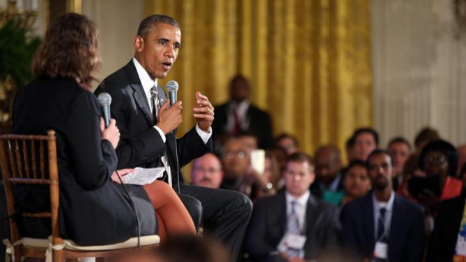President Barack Obama during a event co-hosted by coworker.org during the White House Summit on Worker Voice in the East Room of the White House in Washington, Wednesday, Oct. 7, 2015. On stage with Obama is Michelle Miller, co-founder of coworker.org. (AP Photo/Andrew Harnik)